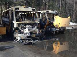 Three buses were total losses and another was damaged, fire officials said.