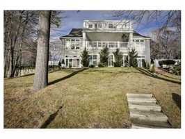 The stately Center Entrance Colonial has a 3 car heated attached garage.