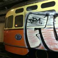 The MBTA said one of the antique cars was extensively defaced and another was also tagged.