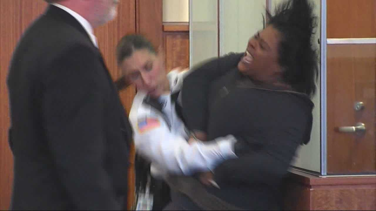 Woman accused of child sex trafficking lashes out inside courtroom