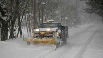 Nearly 20 inches of snow covers spots on the South Shore, Wednesday Jan. 22, 2014. A plow in Marshfield works to clear Old Main Street Extension.