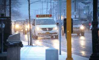 Traffic deals with snowfall on North Main Street in Randolph. Snow began to fall around 4pm across the South Shore as a major winter storm was expected to hit the region, Tuesday, Jan 21, 2014.