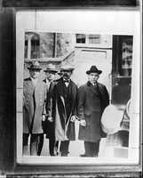 Sacco and Vanzetti, seen here being taken from jail to court, filed a series of appeals and the case drew attention around the world.