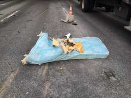 Massachusetts State Police released this photo of a mattress on Route 128 in Burlington after the two vehicle crash.