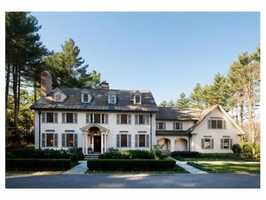 This exquisite Georgian Colonial is in a prestigious Southside neighborhood on 1.67 acres of lush landscaped grounds.