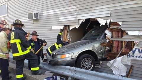 boston fire car into building 020114