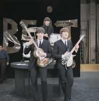 Paul, Ringo and John on the set of the Ed Sullivan Show in New York.