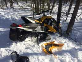 A Manchester firefighter was injured in a snowmobile accident in Auburn.