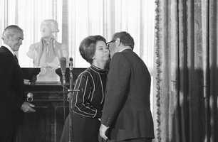 Secretary of State Henry Kissinger gets a kiss from Shirley Temple Black of Santa Monica, Calif., after Mrs. Black was sworn in as the new U.S. Ambassador to Ghana at a State Department ceremony in Washington on Friday, Sept. 20, 1974.