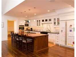 The Professional Kitchen is complimented by a two story fireplace.
