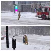 A photo of a local firefighter's act of kindness during Thursday's storm is going viral.