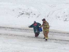 Firefighter Tom Faucher, who was assigned to Manchester Fire Department's Engine 6 during the storm, saw an elderly woman having difficulty crossing Elm Street on Thursday afternoon.