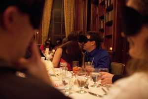 A couple kisses each other every a few minutes during the dinner, while the other four couples at the same table know nothing about it.