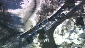 A freight train has derailed on a trestle in Westford.