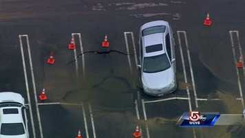 A sinkhole swallowed the front of a car in Burlington.