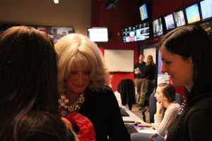 Newscast producers Lisa Simmons and Barbara Baranowski present Susan with a gift.