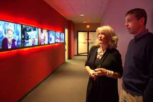 WCVB Creative Services director Russ Nelligan shows Susan a surprise: The monitors in our main hallway were all changed to a montage of moments from her 33 years at WCVB.