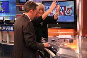 With News Director Andrew Vrees, Susan needs a bit of help untangling the wires.