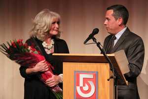 Susan holds roses she was given by WCVB-TV News Director Andrew Vrees