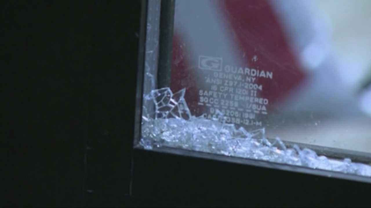Police investigate more than 2 dozen broken windows
