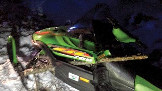 Tree impales snowmobile, throwing rider