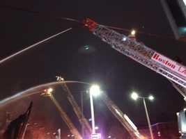 Fire crews battled a massive blaze early Monday in Boston's Roxbury neighborhood.