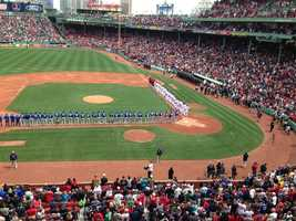 The ceremony took place before the Red Sox played against the Kansas City Royals. The Sox had postponed Friday night's game amid a massive manhunt.