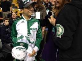Louis was able to get autographs on a Celtics hat before the start of the game Wednesday night.