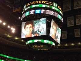 The crowd cheered for Louis when his picture showed up high above TD Garden Wednesday night.