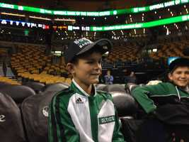 Louis was very excited when he took his seat before the game started Wednesday night.