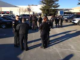 Police officers gather at the Burlington Mall before departing for Rhode Island