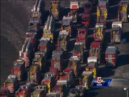 The convoy of fire engines gathered at Gillette Stadium