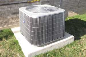 Schedule a cooling system check. As much as half of the energy used in your home goes to heating and cooling, says EnergyStar.gov.