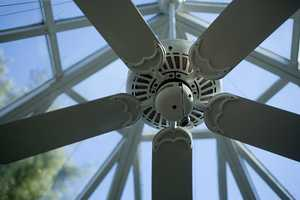 Consider reversing the motor on your ceiling fans.When the blades run in a clockwise direction, they force warm air that collects near the ceiling down into the living space.