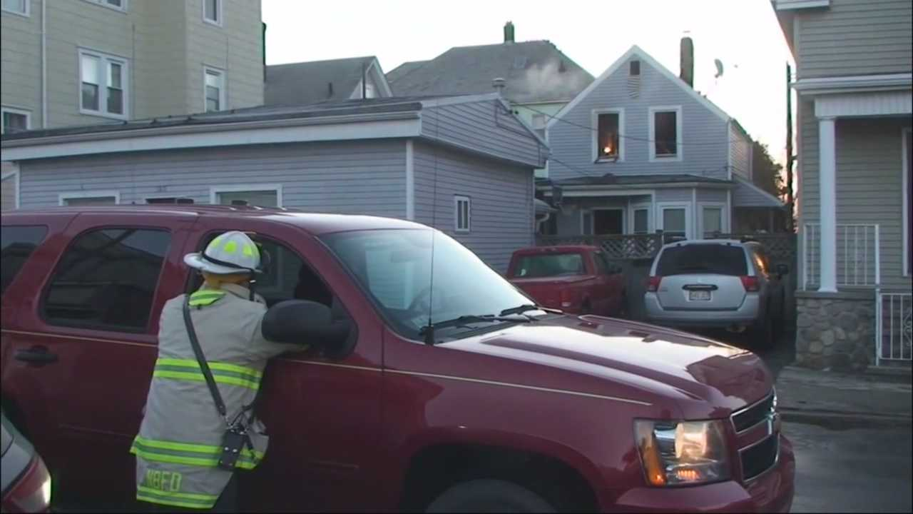 Boy's 911 call saves 2 trapped in New Bedford fire