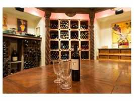 A custom wine cellar with hand carved Mexican columns