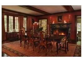Formal living room and spacious dining room with fireplaces beckons guests.