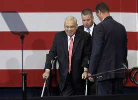 Boston Mayor Thomas Menino walks on crutches to the podium to speak in support of Democratic U.S. Senate candidate Edward Markey during a campaign rally in Boston's Roxbury neighborhood, Wednesday, June 12, 2013.