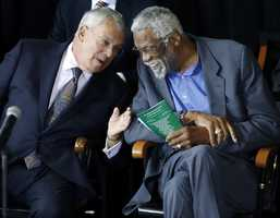 Former Boston Celtics basketball star Bill Russell, right, chats with Boston Mayor Thomas Menino during a ceremony honoring Russell after his statue was unveiled at City Hall Plaza in Boston, Friday, Nov. 1, 2013.