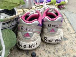 At the beginning of May 2013 I was in Boston for a writing conference, which was taking place not far from the Marathon bombing. I went to see the spot. What I most noticed that I was suddenly fearful of every young man with a black backpack. This is a photo from the memorial at Copley Square.