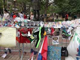 Messages of support with hands of support banners and other items at the Copley Square Memorial for the 2013 Boston Marathon