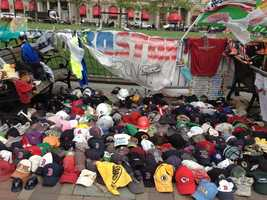 Hats and other sports items left at the Copley Square Memorial for the 2013 Boston Marathon.