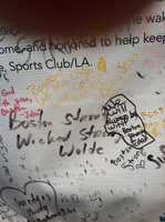 "This is one of a series of photos I took on the last day of the Copley Square memorial site for the Boston Marathon bombings. This photo is a close-up of a large banner of signatures and well-wishes from visitors to the memorial. In the center is the message ""Boston strong. Wicked Strong -Wolfe"""
