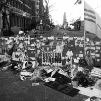 This is a image of Boylston St. on the first day that people were out and about following the events of the Boston Marathon bombing. I took the photo after an afternoon of walking around town. Many people were out on the streets of Boston that day. There was a distinct feeling of community in the air as we enjoyed the city together again.
