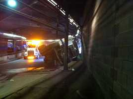 A cement truck crashed on the tunnel exit ramp from the Massachusetts Turnpike to Copley Square Friday.