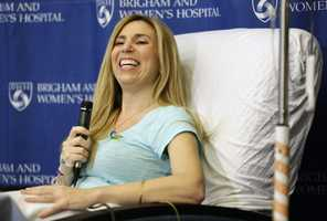 Heather Abbott, of Newport, R.I., smiles while taking questions from reporters during a news conference at Brigham and Women's Hospital, in Boston, Thursday, April 25, 2013. Abbott underwent a below the knee amputation during surgery on her left leg following injuries she sustained at the Boston Marathon bombings on April 15.