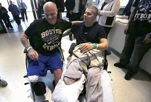 Paul Norden, left, and his brother J.P., both suffering limb-loss and major blast-related injuries in the Boston Marathon bombing. This picture is from Spaulding Rehabilitation Hospital in Boston on May 13, 2013.