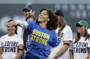 Patty Campbell, of Medford, Mass., mother of Krystle Campbell, who was killed in the Boston Marathon bombing, throws out a ceremonial first pitch prior to a baseball game between the Boston Red Sox and the Minnesota Twins at Fenway Park in Boston, May 7, 2013.