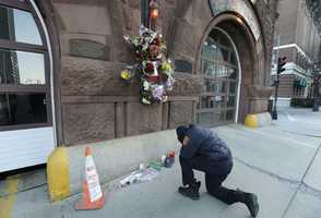 Somerville, Mass. firefighter Earl Johnson kneels to pray in front of a makeshift memorial on the front of fire station Engine 33, Thursday, March 27, 2014, in Boston. Fire station Engine 33 was the station of fallen firefighters Lt. Edward J. Walsh and Michael R. Kennedy who lost their lives fighting a 9-alarm fire in a four-story brownstone in Boston's Back Bay neighborhood.