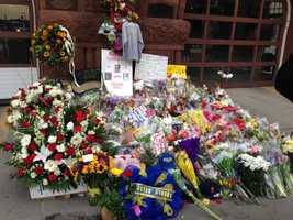 The memorial grows outside Engine 33 on Boylston Street.